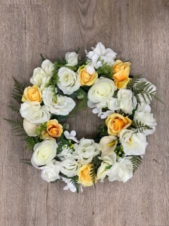Yellow and white artificial wreath