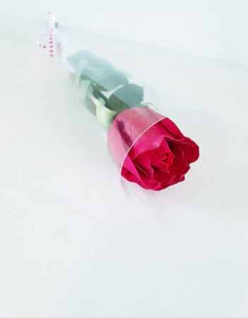 Single rose in tube artificial